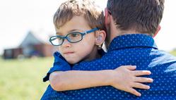boy-hugging-father