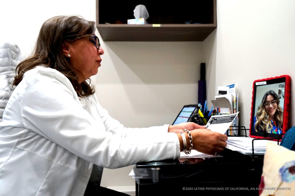 Telehealth Appt Between Latina Doctor and Patient-2