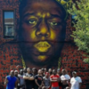 Black men running mural group pic
